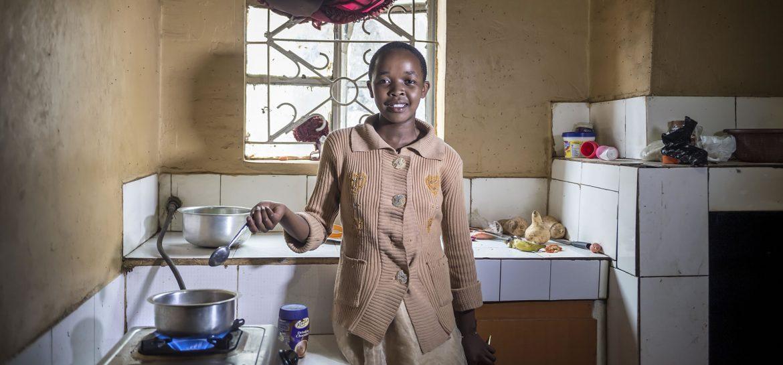 A girl in Nakuru Kenya cooking with biogas