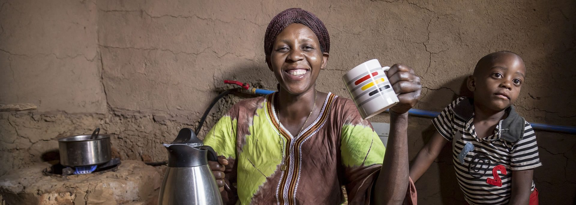Happy mother and son using biogas to prepare breakfast